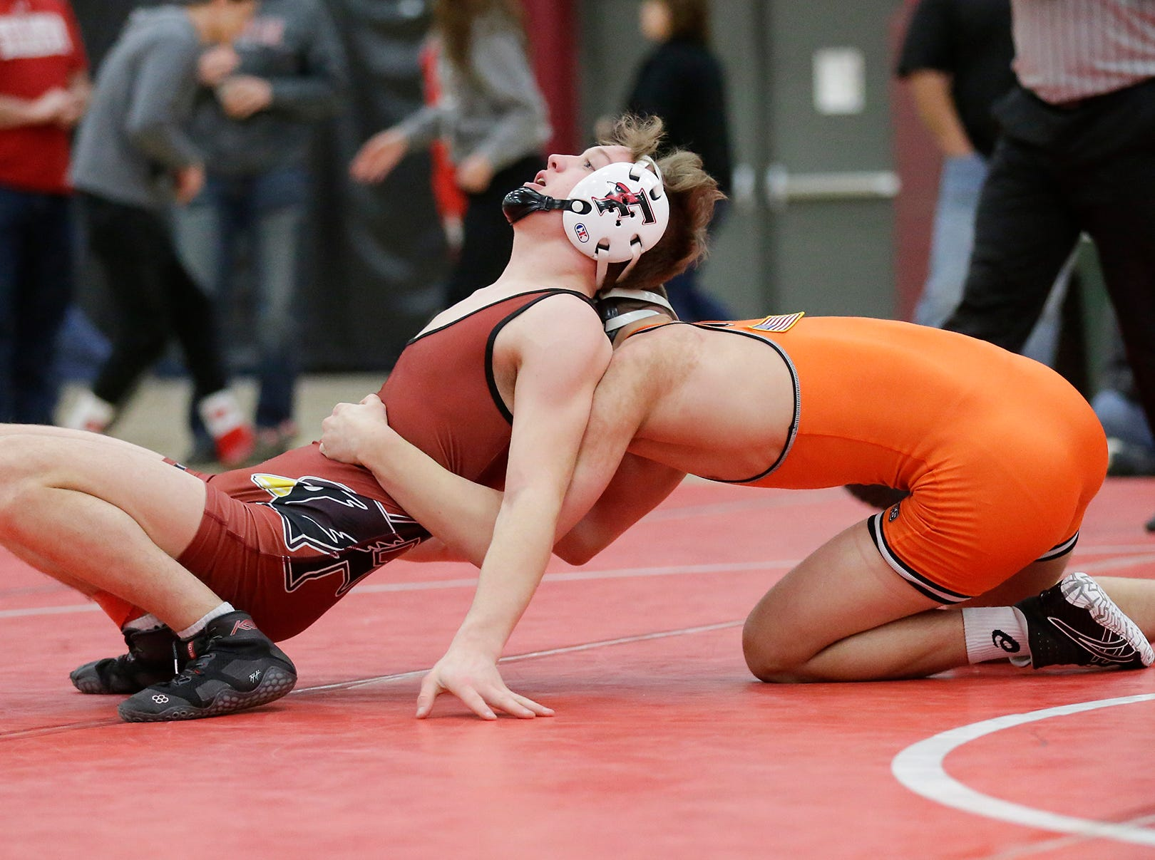 Fond du Lac High School's Tristan Lakey wrestles Kaukauna High School's Logan Stumpf in a 126-pound match during the Fox Valley Association wrestling championship meet held Saturday, Feb. 2, 2019, in Fond du Lac. Stumpf won the match by a score of 5-3.