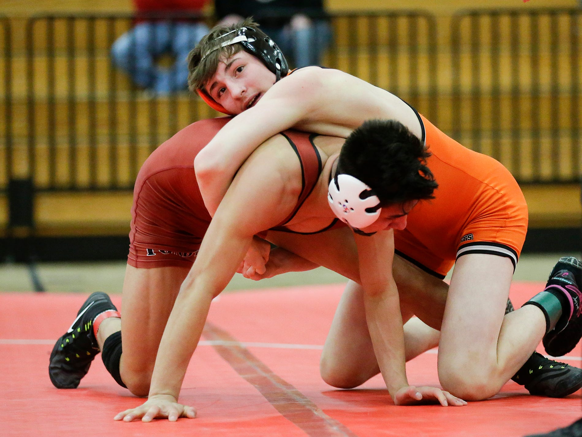 Kaukauna High School's John Diener wrestles Fond du Lac High School's Issac Ortegon in a 138-pound match during the Fox Valley Association wrestling championship meet held in Fond du Lac, Saturday, Feb. 2, 2019. Ortegon won the match by a score of 8-5.