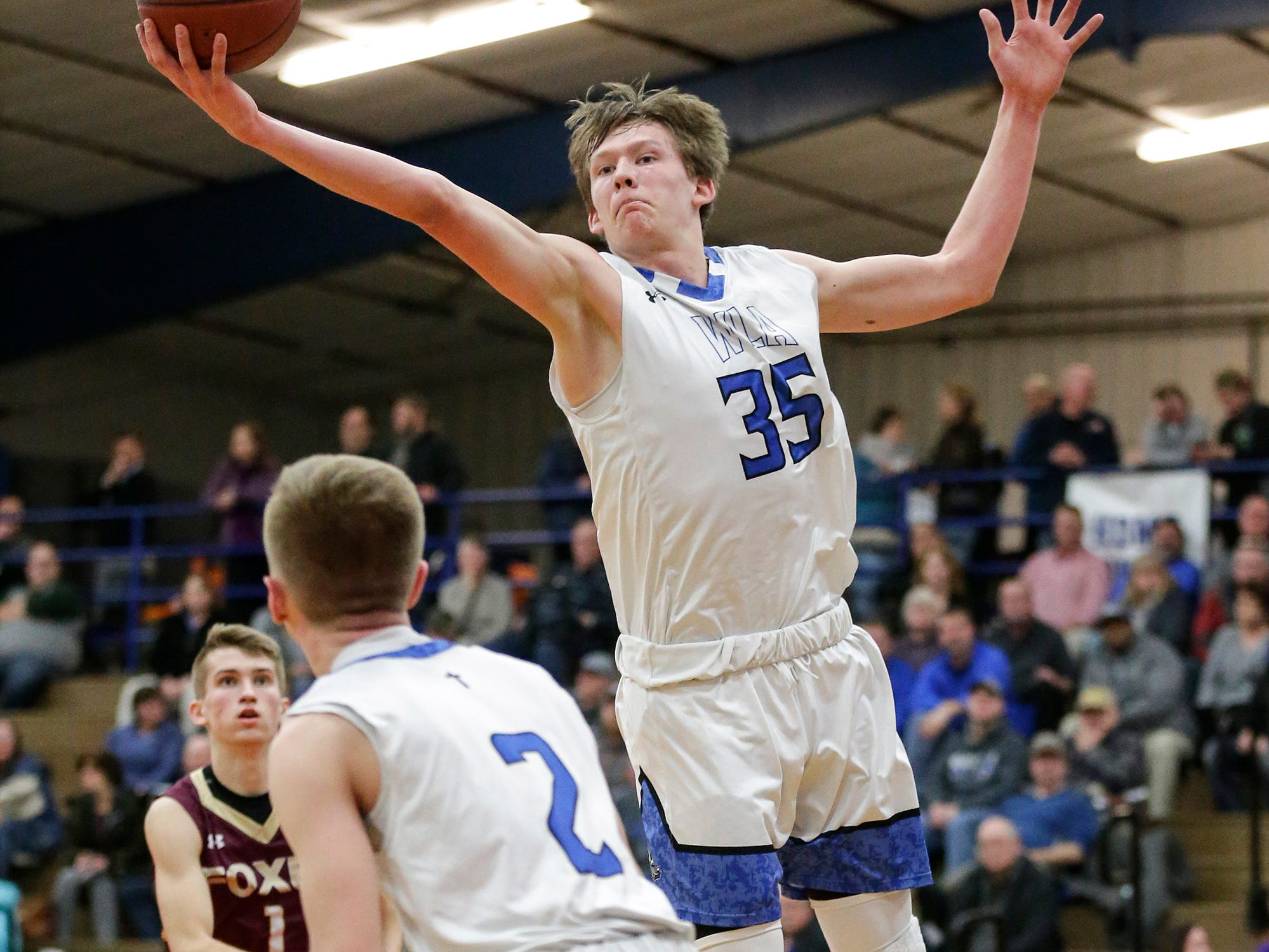 Winnebago Lutheran Academy boys basketball's Gabe Pruss (35) reaches for a rebound against Omro High School during their game Friday, February 1, 2019 in Fond du Lac. Doug Raflik/USA TODAY NETWORK-Wisconsin