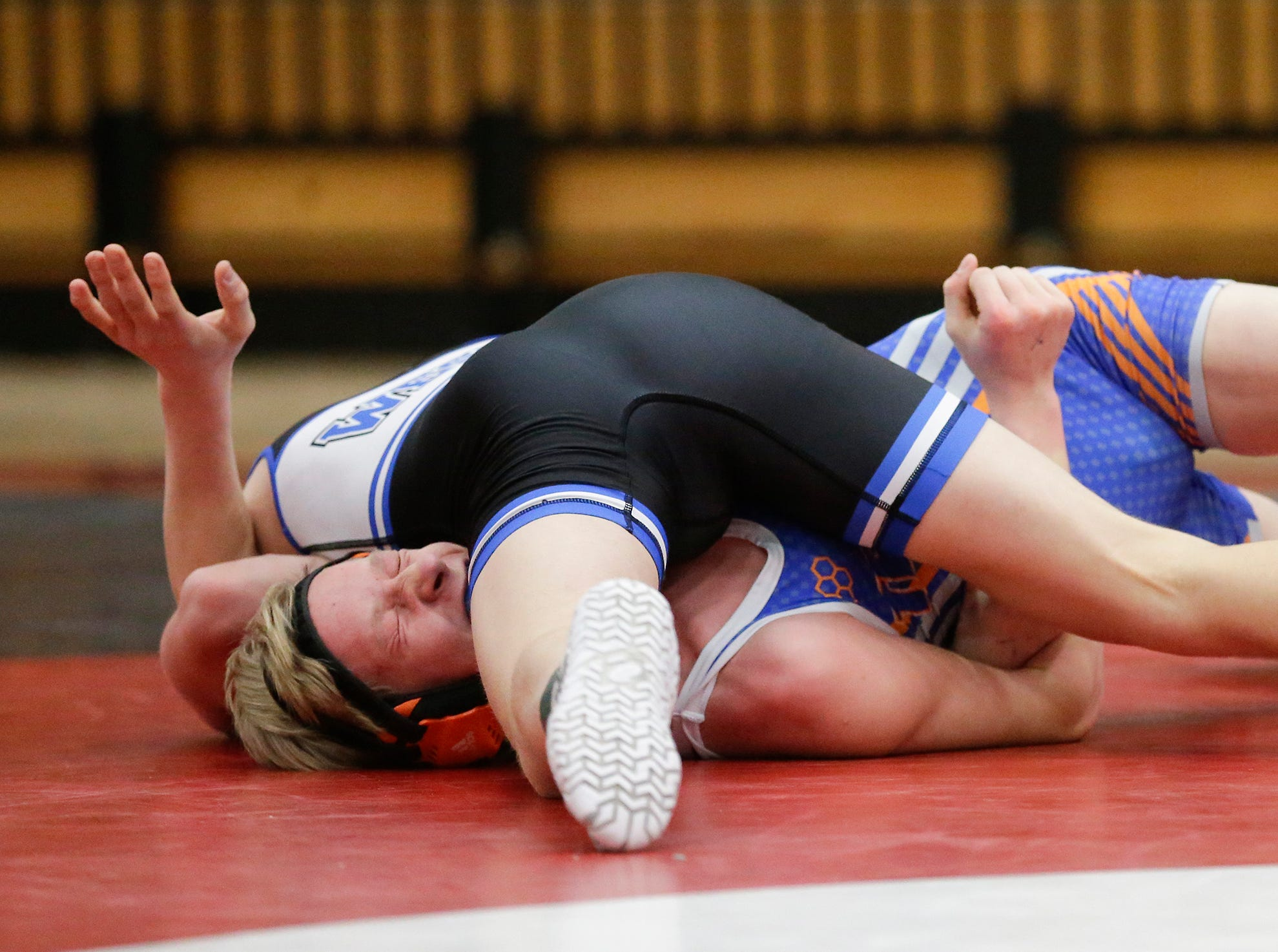 Oshkosh West High School's Jack Zangl wrestles Appleton West High School's Chase Wendt in a 120 pound match during the Fox Valley Association wrestling championship meet held in Fond du Lac, Saturday, February 2, 2019. Zangl won the match by a pin. Doug Raflik/USA TODAY NETWORK-Wisconsin
