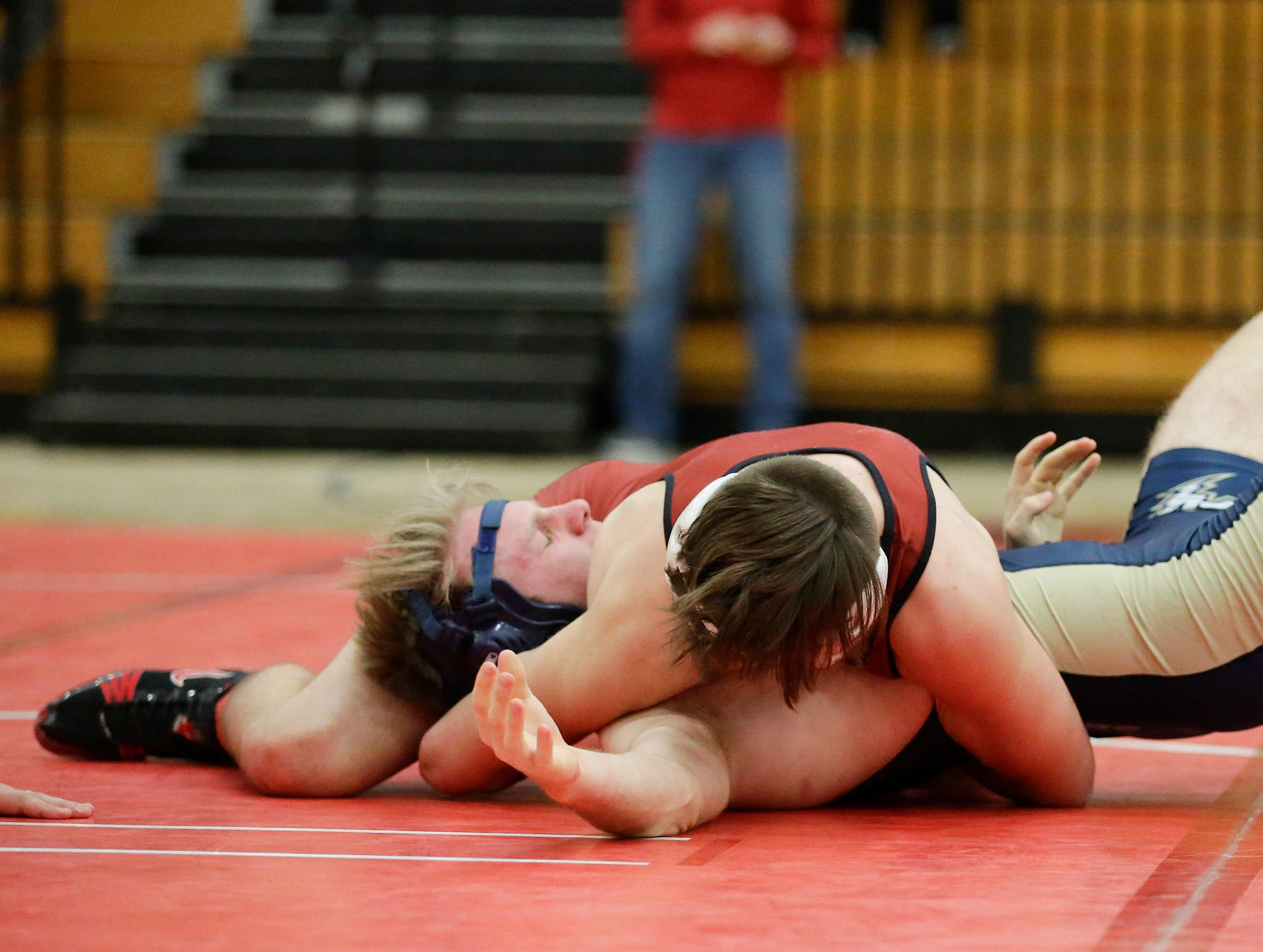 Fond du Lac High School's Josiah Streblow wrestles Appleton North High School's Blake Koehler in a 152-pound match during the Fox Valley Association wrestling championship meet held Saturday, Feb. 2, 2019, in Fond du Lac. Streblow won the match by a pin.
