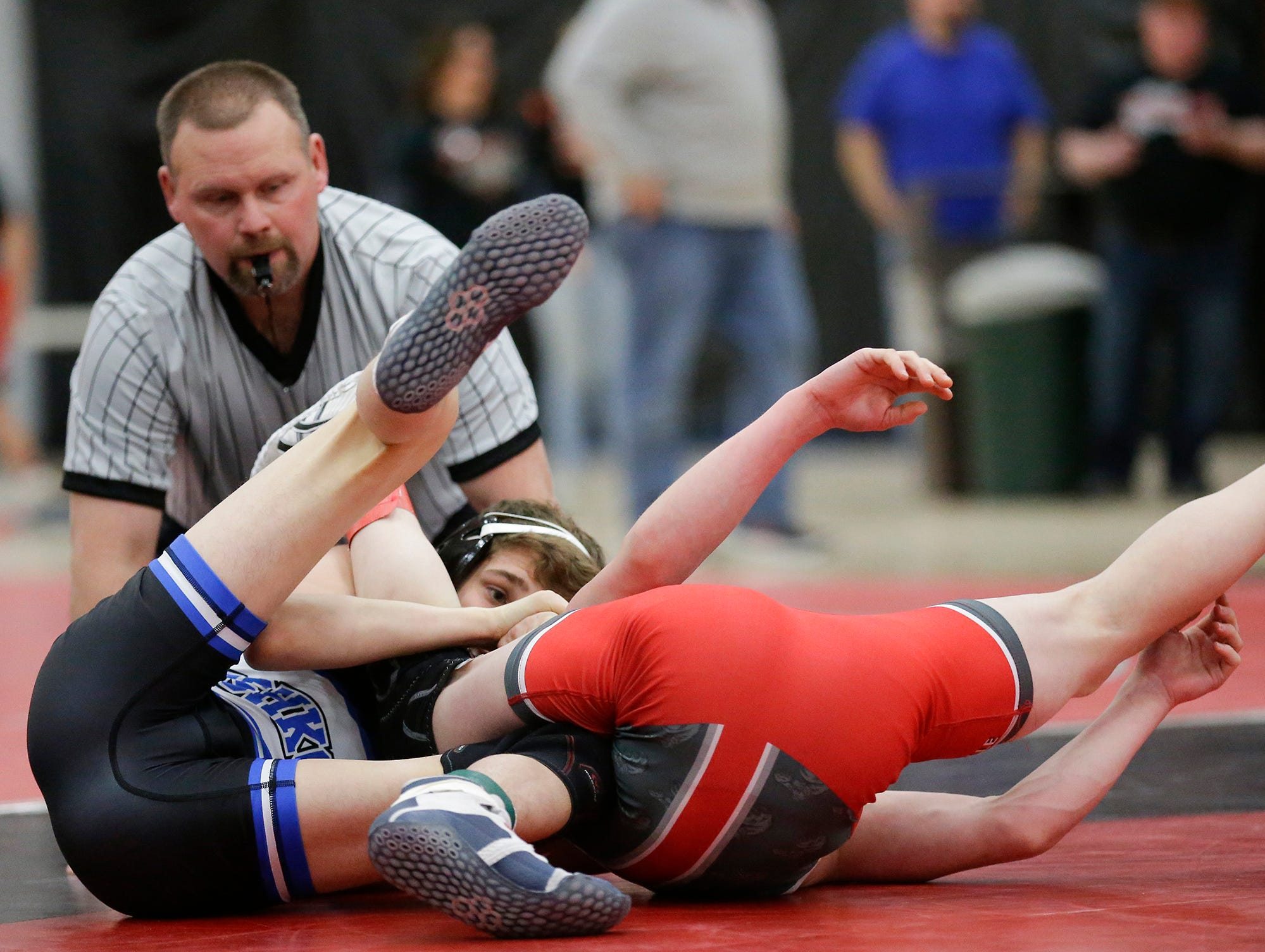Oshkosh West High School's Alec Hunter wrestles Hortonville High School's Austin Spindler in a 106-pound match during the Fox Valley Association wrestling championship meet held in Fond du Lac, Saturday, Feb. 2, 2019. Hunter won the match by a pin.