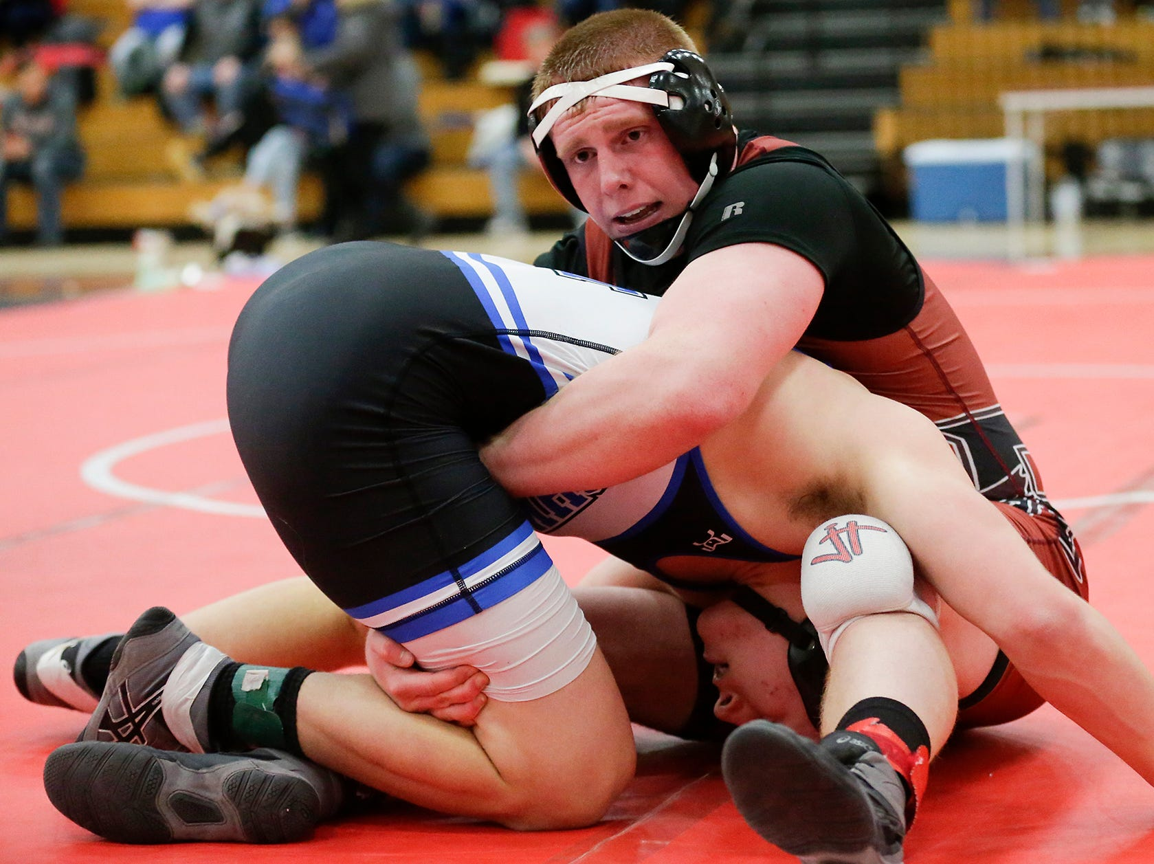 Oshkosh West High School's Blake Framke wrestles Fond du Lac High School's Austin Baatz in a 195-pound match during the Fox Valley Association wrestling championship meet held Saturday, Feb. 2, 2019, in Fond du Lac. Baatz won the meet by a pin.