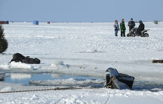 Dan Kleinhans' truck is chained to the ice to prevent it from sinking all the way after it broke through the ice during sturgeon spearing season on Lake Winnebago on Feb. 14, 2009. Kleinhans and his 9-year-old daughter, Savannah, were killed and 7-year old Tiffany Dombrowksi survived the ordeal, even though she was submerged for 30 minutes.