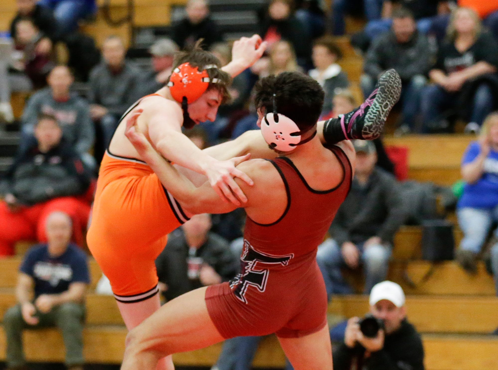 Kaukauna High School's John Diener wrestles Fond du Lac High School's Issac Ortegon in a 138-pound match during the Fox Valley Association wrestling championship meet held Saturday, Feb. 2, 2019, in Fond du Lac. Ortegon won the match by a score of 8-5.