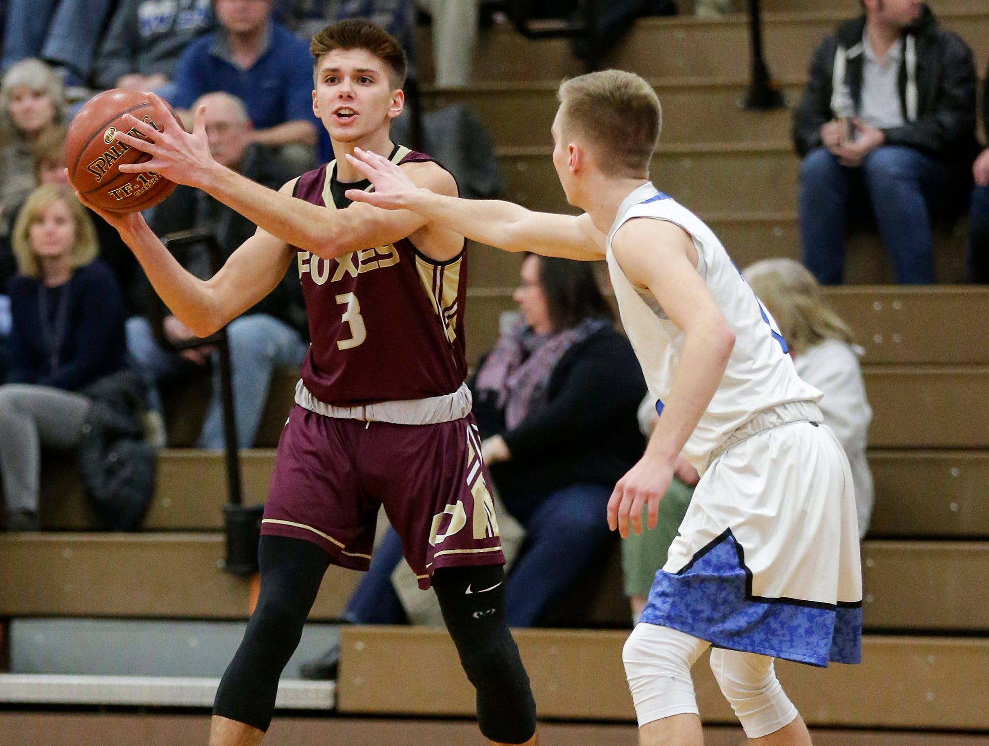 Omro High School boys basketball's Austin Bauer (3) looks to pass against Winnebago Lutheran Academy's Ryan Reigand (2) during their game Friday, February 1, 2019 in Fond du Lac. Doug Raflik/USA TODAY NETWORK-Wisconsin