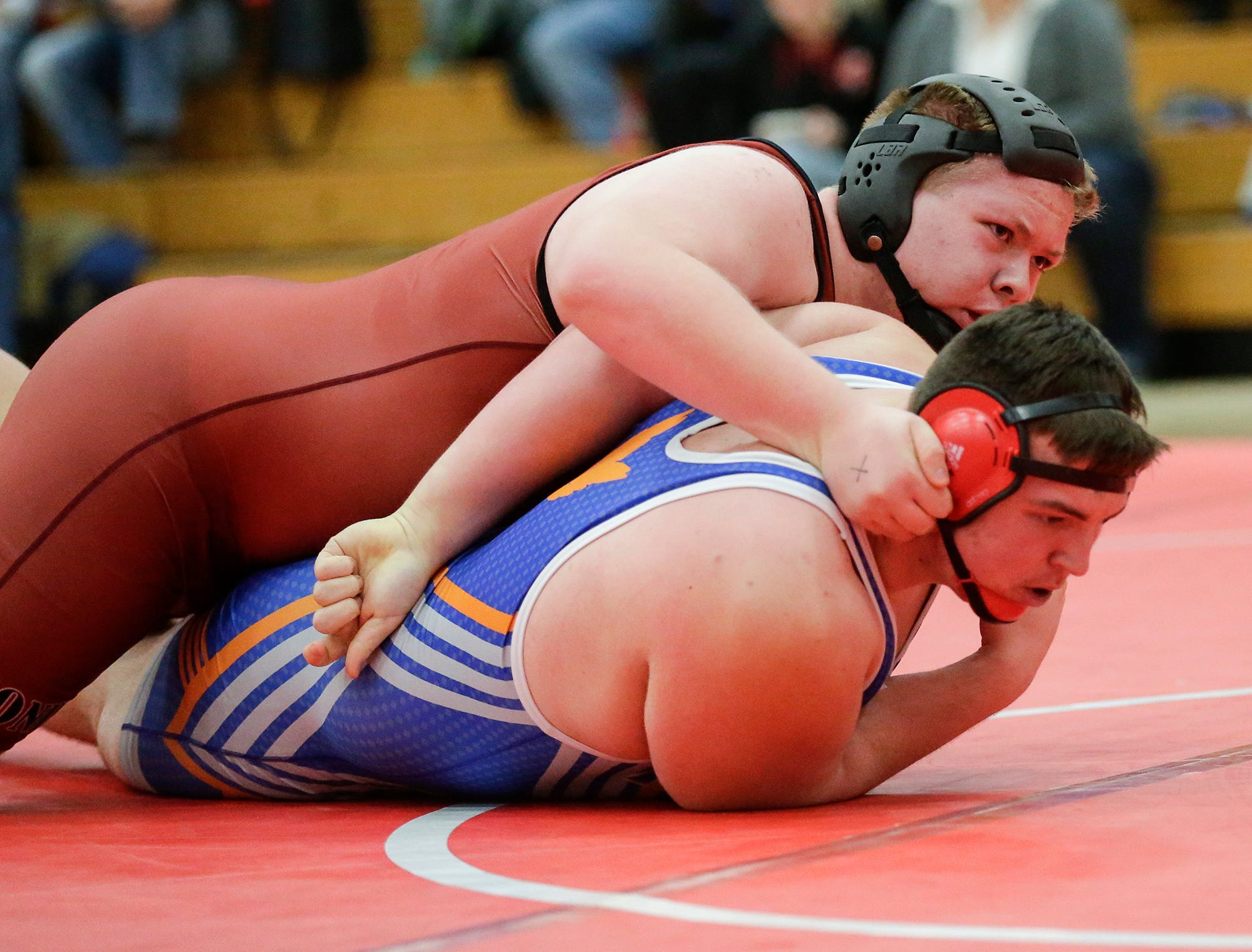 Fond du Lac High School's Joe Schmitz wrestles Appleton West High School's Keaven Hanser in a 285-pound match during the Fox Valley Association wrestling championship meet held in Fond du Lac, Saturday, Feb. 2, 2019. Schmitz won the match by a pin.