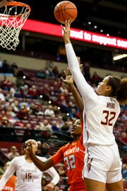 Freshman forward Valencia Myers (32) was a powerful force against Miami on Thursday night at the Tucker Center.