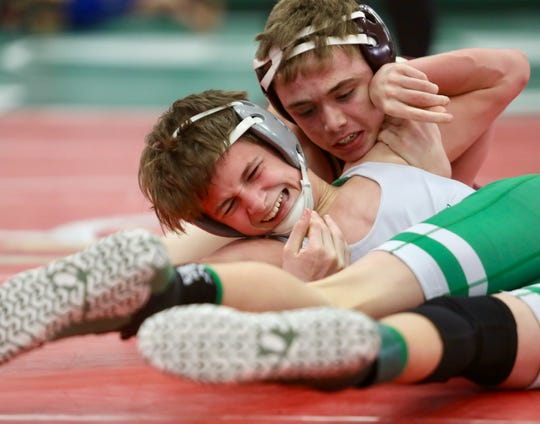 Jacob Bennett of Riverdale wrestles John Vadyak of Fort Myers in the 108-pound weight class finals during the LCAC Championships on Saturday, Feb. 2, 2019, at Fort Myers High School. Bennett won the match.