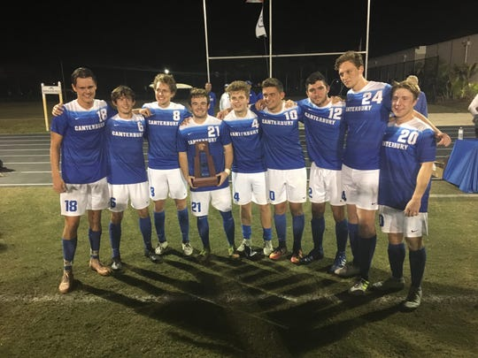 The Canterbury School seniors hold the District 1A-8 boys soccer championship trophy.