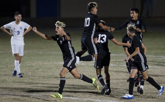 Mariner High School soccer players celebrate scoring a goal against Cape Coral on Friday in the District 3A-13 title game at Cape. Mariner beat Cape 4-3.