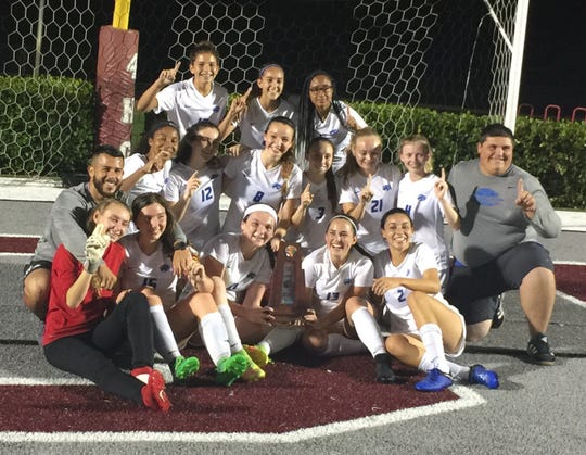 The Canterbury girls soccer team celebrates is District 1A-8 title.