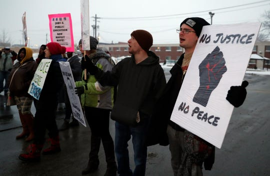 About 25 people gathered across the street from the Green Bay Police Department on Feb. 2, 2019 to protest the announcement made by District Attorney David Lasee that Officer Erik O'Brien's actions were legal when he shot Jonathon Tubby on Oct. 19, 2018. Sarah Kloepping/USA TODAY NETWORK-Wisconsin