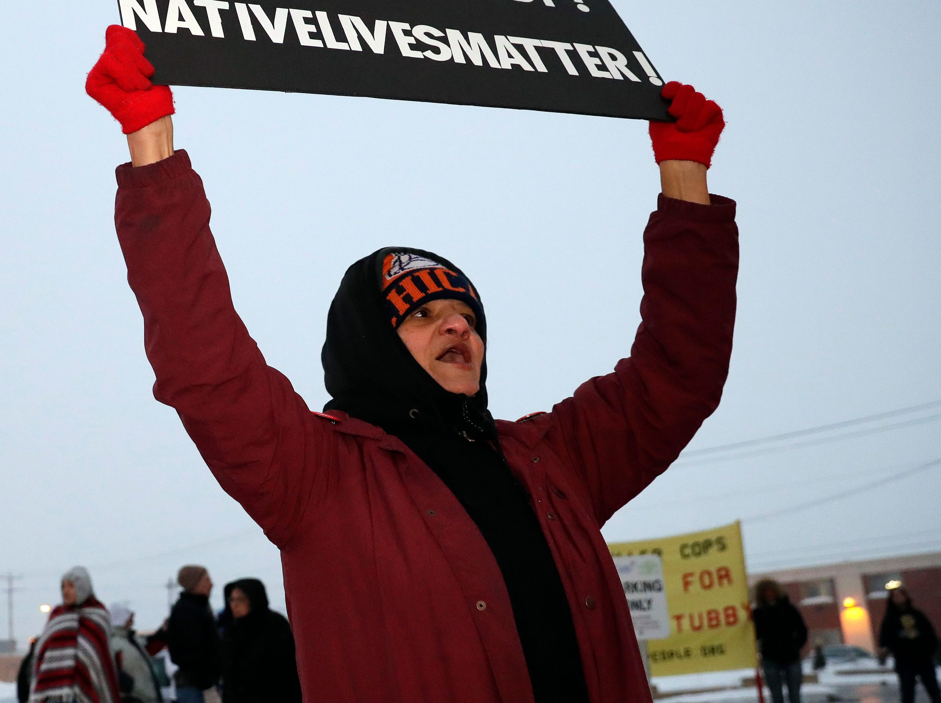 Stacy Grignon of Green Bay protests across the street from the Green Bay Police Department on Feb. 2, 2019 after the announcement made by District Attorney David Lasee that Officer Erik O'Brien's actions were legal when he shot Jonathon Tubby on Oct. 19, 2018. Sarah Kloepping/USA TODAY NETWORK-Wisconsin