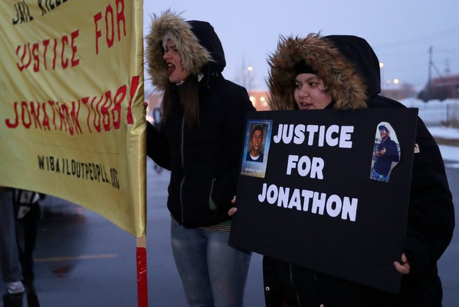 """About 25 people gathered across the street from the Green Bay Police Department on Feb. 2, 2019 to protest Brown County District Attorney David Lasee's decision that Green Bay police officer Erik O'Brien's actions were legal when he fatally shot Jonathon Tubby in the county jail's """"sally port"""" on Oct. 19, 2018."""
