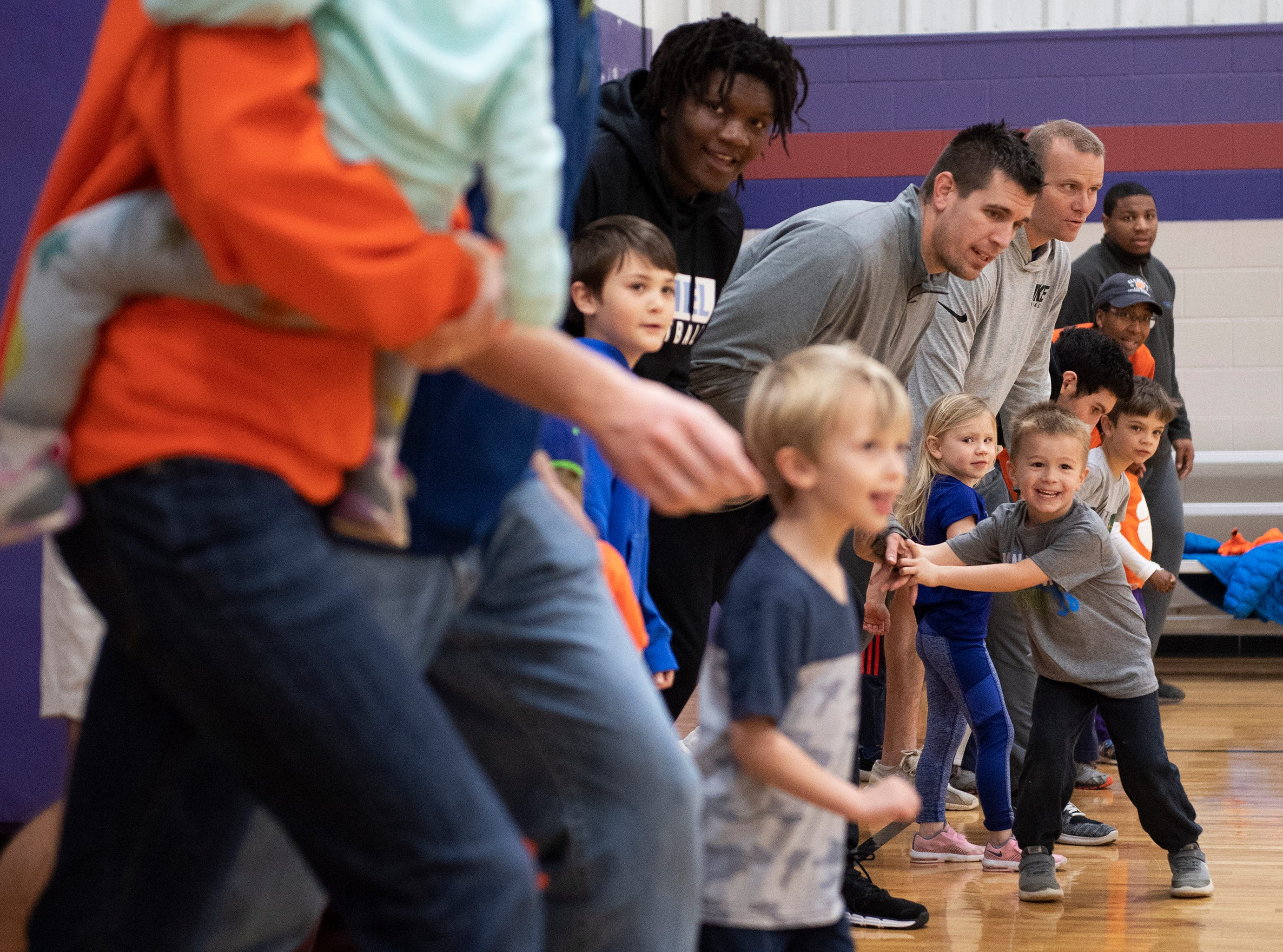 Parents and kids work on basketball drills with players and coaches from D.W. Daniel High School during the Smart Start Basketball program at Central-Clemson Recreational Center Saturday, Feb. 2, 2019.