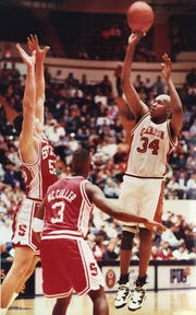 Clemson center Sharone Wright (right) shoots near N.C. State players on January 29, 1994 at Littlejohn Coliseum. The Tigers won the game 95-73.