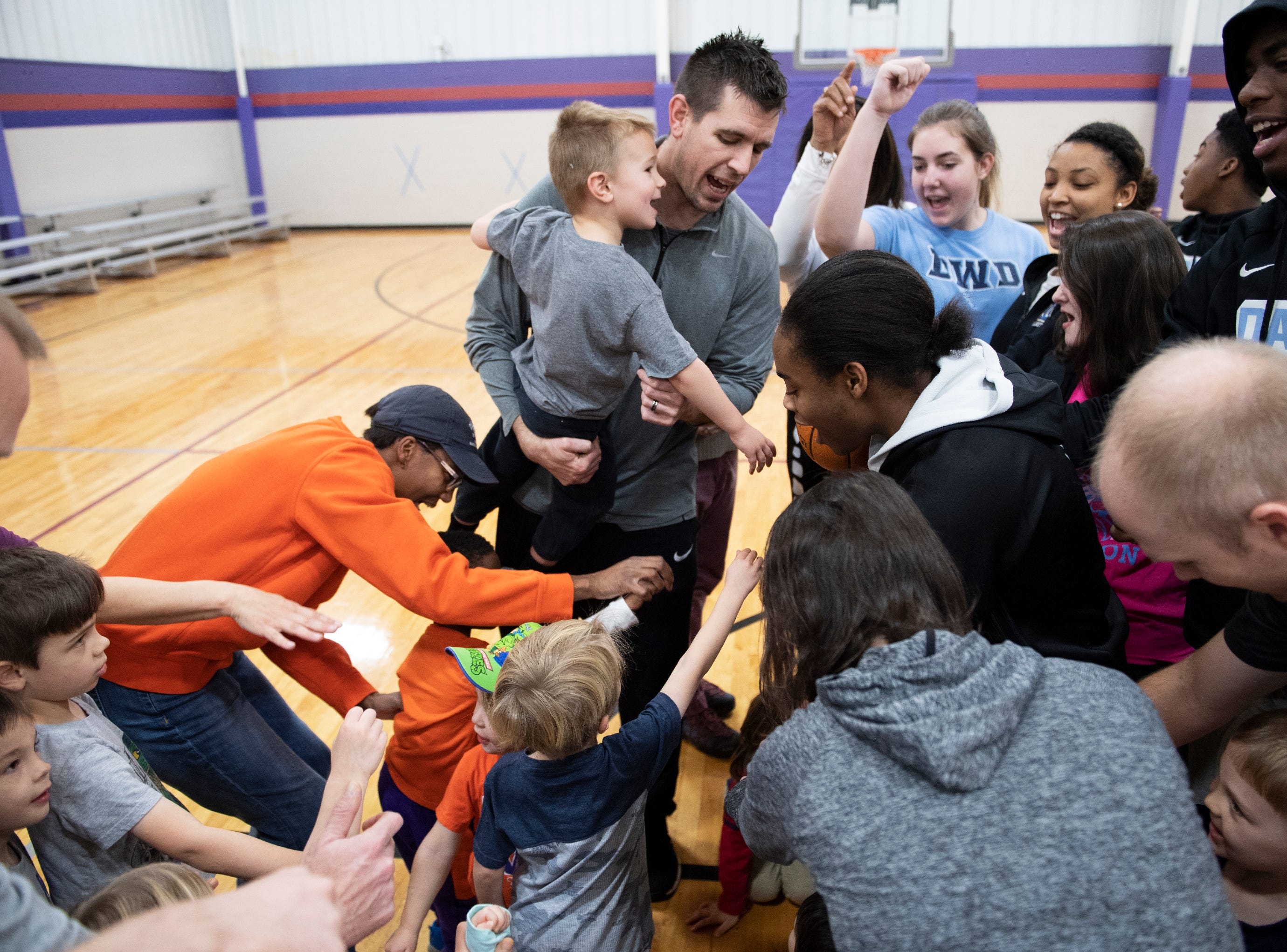 Ben Touchberry, head coach of D.W. Daniel High School boys basketball, leads a cheer for participants at the Smart Start Basketball program at Central-Clemson Recreational Center Saturday, Feb. 2, 2019.