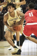 Wake Forest's Sharone Wright Jr. (2) drives against Cornell.