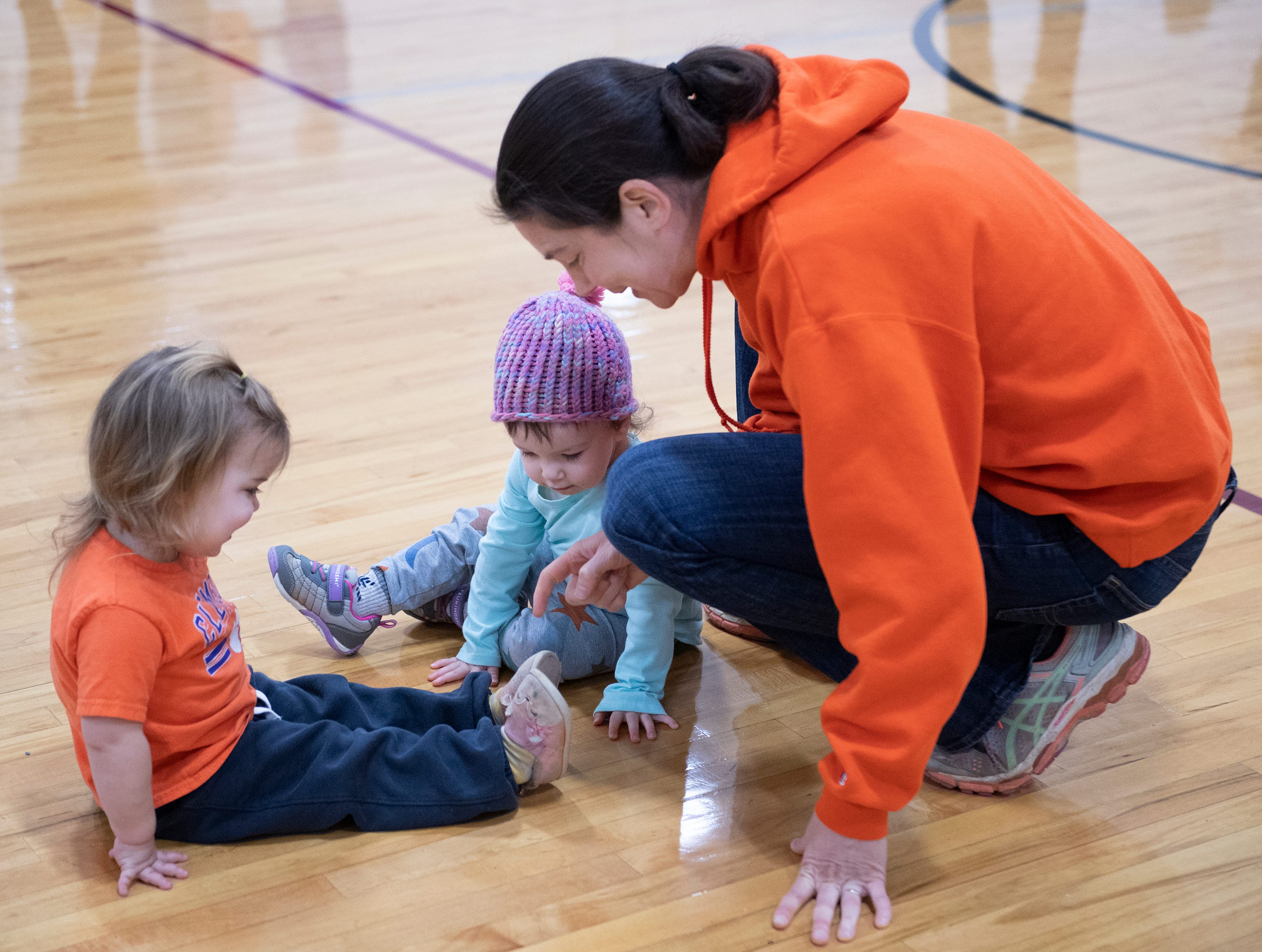 From right, Devon Gorry talks with Sage Gorry, 1, and May Shaughnessy, 2, during the Smart Start Basketball program at Central-Clemson Recreational Center Saturday, Feb. 2, 2019.