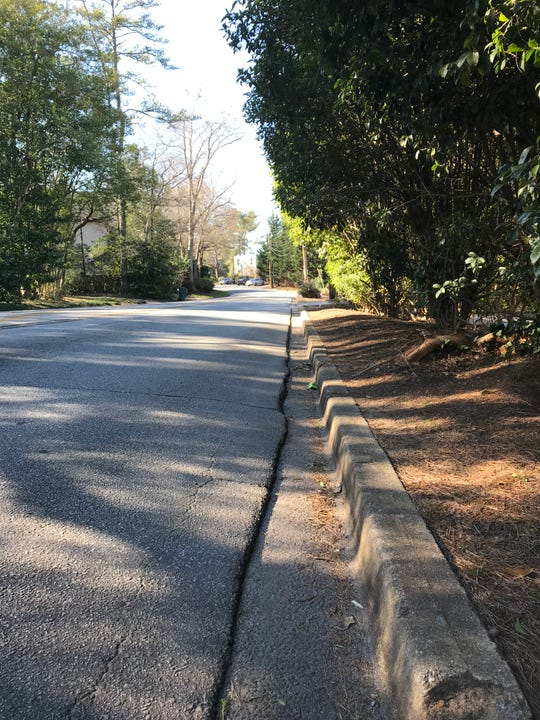 The sidewalk from the Swamp Rabbit Trail to near the YMCA ends abruptly along Cleveland Street, but the city is planning to fill the gap that would connect to downtown.