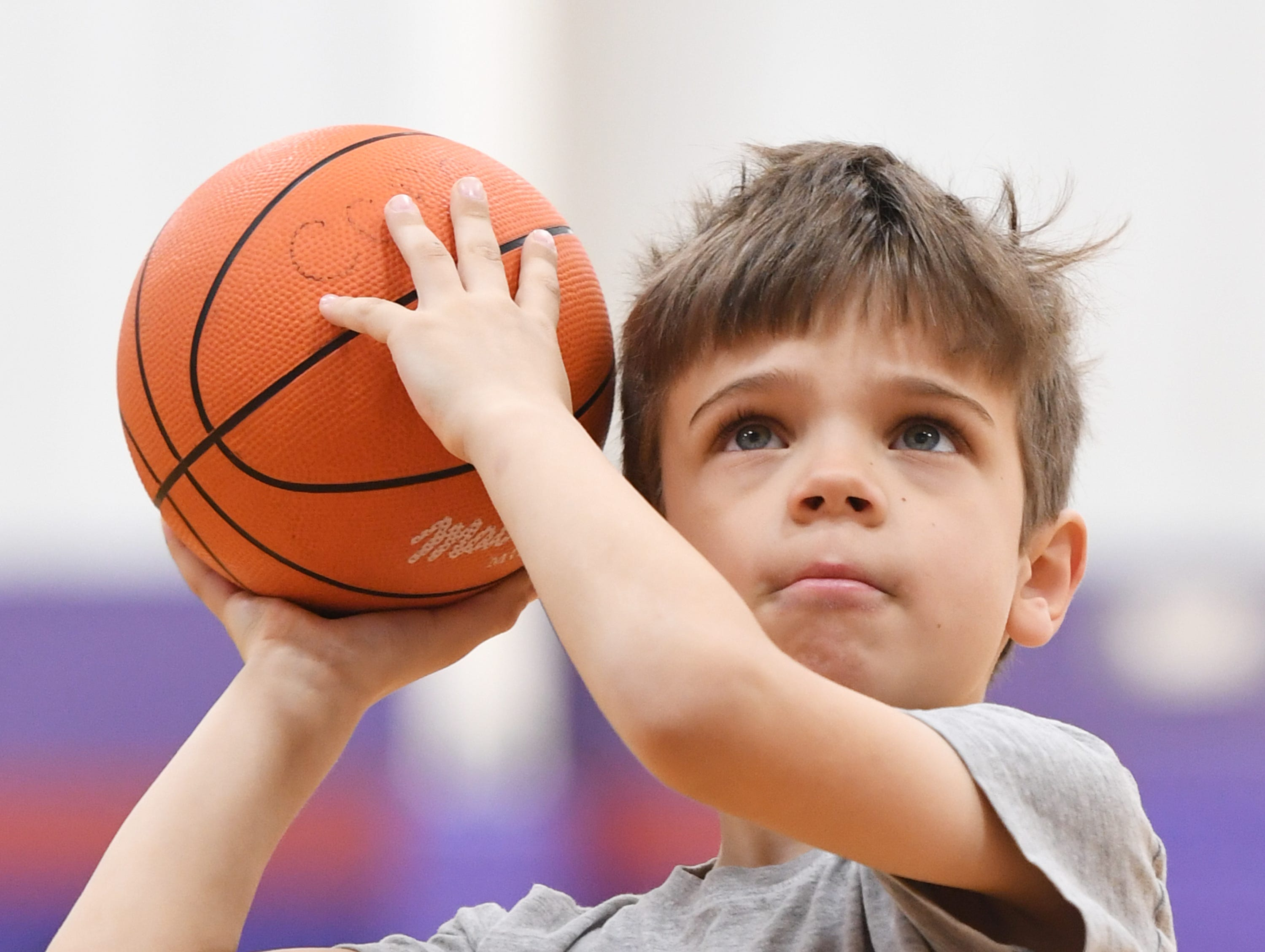 Filip Ziolkowski, 6, practices his shooting at Central-Clemson Recreational Center Saturday, Feb. 2, 2019.