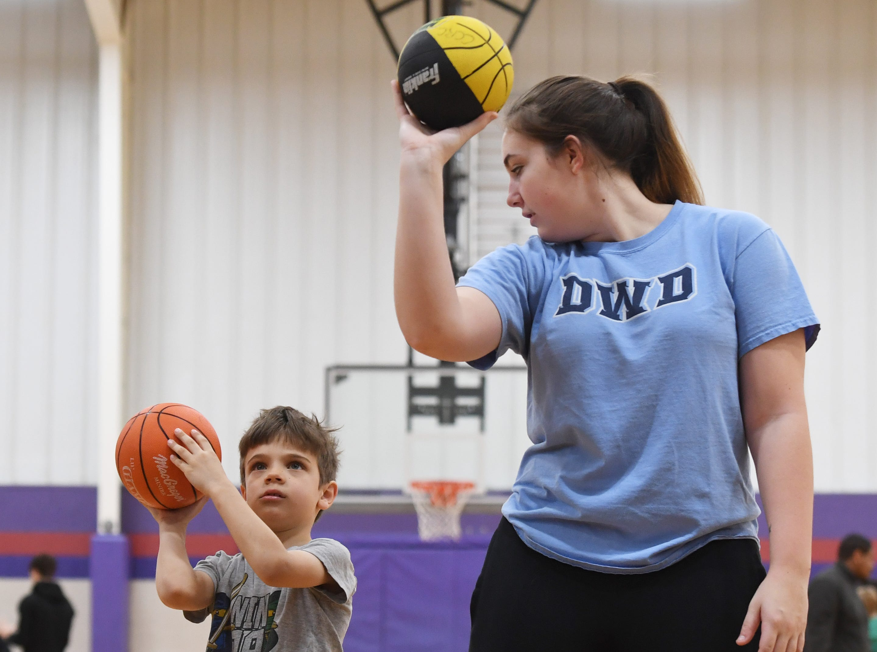 D.W. Daniel High School junior Jamie Thomas helps Filip Ziolkowski, 6, during the Smart Start Basketball program at Central-Clemson Recreational Center Saturday, Feb. 2, 2019. Ziolkowski was there while his mom, and 4 year-old twin siblings.