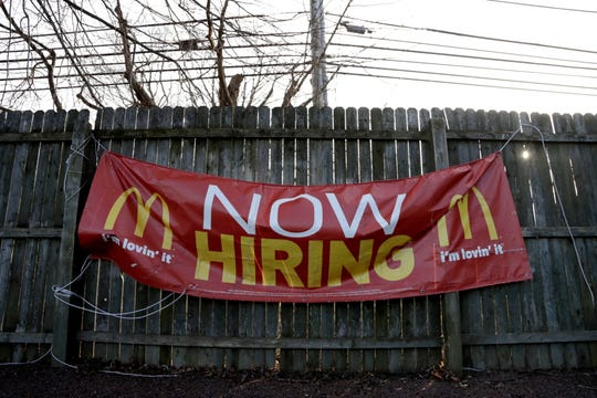 In this Jan. 3, 2019, photo an employment sign hangs from a wooden fence on the property of a McDonald's restaurant in Atlantic Highlands, N.J. On Friday, Feb. 1, the U.S. government issues the January jobs report, which will reveal the latest unemployment rate and number of jobs U.S. employers added.