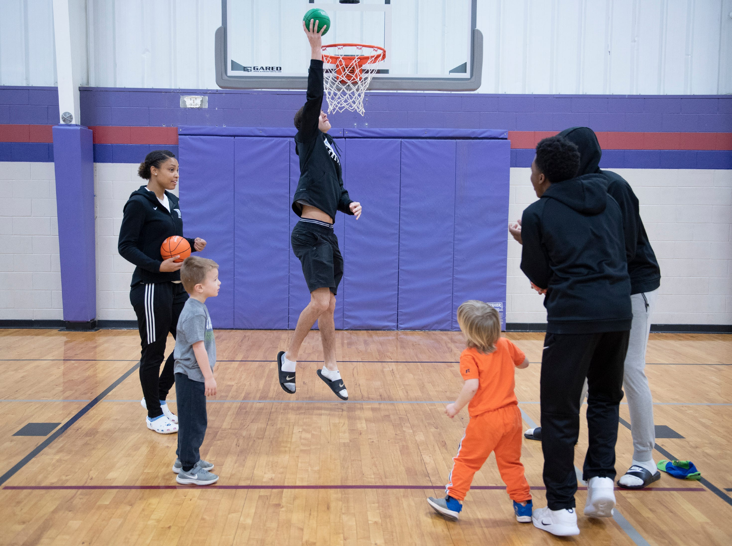 D.W. Daniel High School basketball players work with young children and their parents at the Smart Start Basketball program at Central-Clemson Recreational Center Saturday, Feb. 2, 2019.