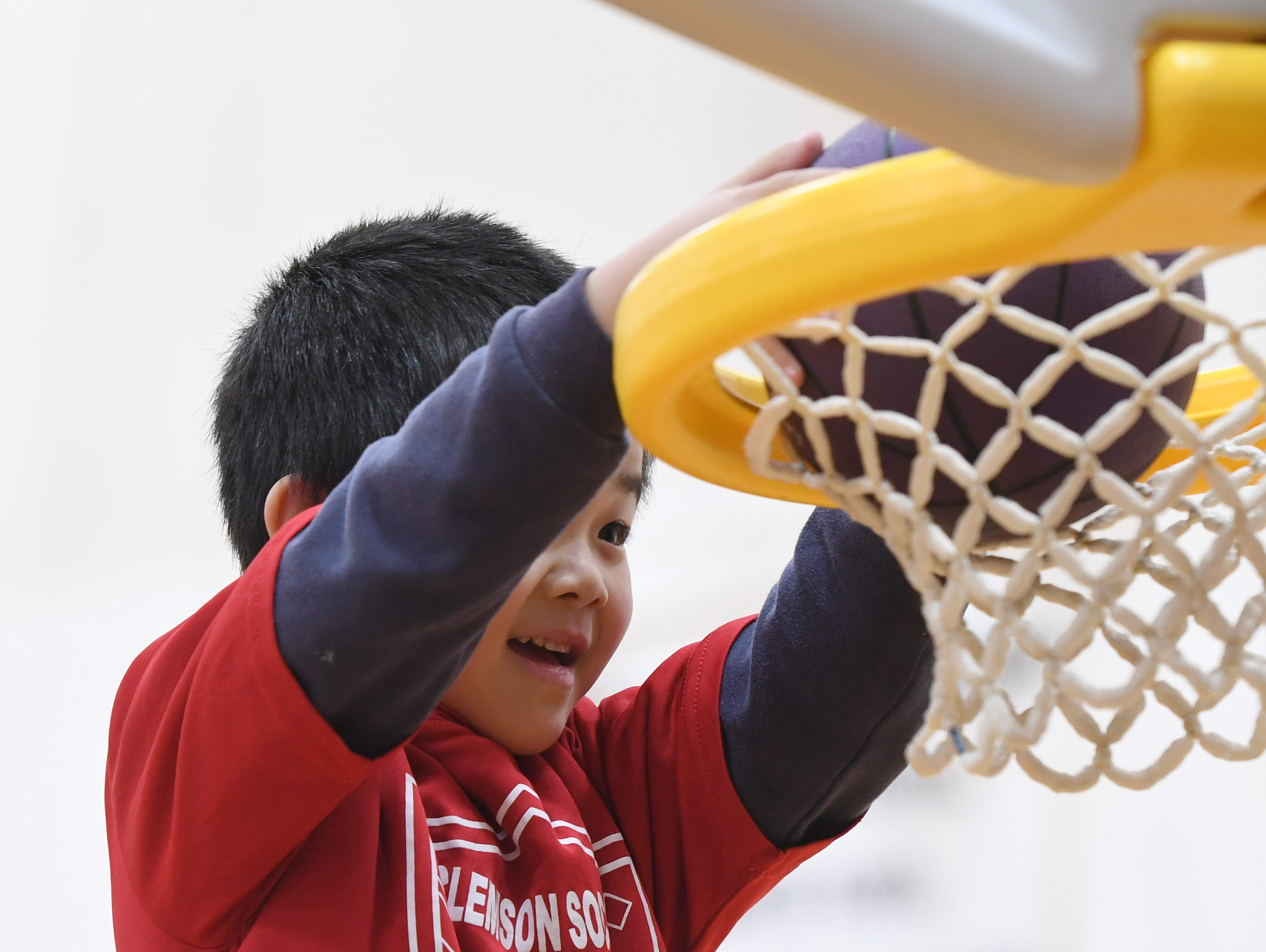 Paul Chang, 4, dunks the ball during the Smart Start Basketball program at Central-Clemson Recreational Center Saturday, Feb. 2, 2019.