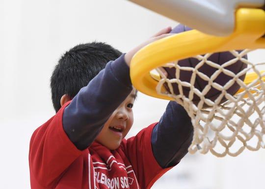 Paul Chang, 4, dunks the ball during the Smart Start Basketball program at Central-Clemson Recreational Center Saturday, Feb. 2, 2019.