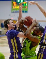 The Providence men, shown facing Carroll College Friday night, upset their second striaght ranked competition when they beat Rocky Saturday in the McLaughlin Center.