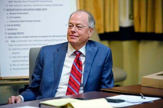 FILE - In this Nov. 14, 2018 file photo, state Senate Majority Leader Fred Thomas, R-Stevensville, sits in on the Senate Republican caucus meeting at the State Capitol in Helena, Mont. Thomas revealed Friday, Feb. 1, 2019 there was an allegation of sexual harassment involving state legislators about a year ago that made it clear the state needed to have a better policy to investigate and deal with harassment and retaliation claims. (Thom Bridge/Independent Record via AP, File)