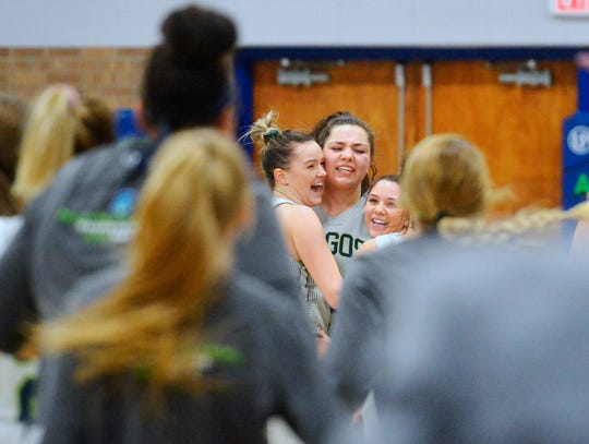 The University of Providence women's basketball team celebrates their victory over Carroll College on Friday night in the McLaughlin Center.
