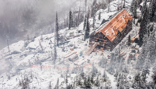 FILE - This Oct. 3, 2018, file photo provided by the Glacier National Park Conservancy shows the Sperry Chalet under renovation in Glacier National Park, Mont. Glacier National Park officials' main concern upon returning to work this week was in assessing how far behind the shutdown left them in their seasonal hiring process. The Montana park's year-round staff of 100 swells by another 400 to 500 starting in April. (Glacier National Park Conservancy via AP, File)