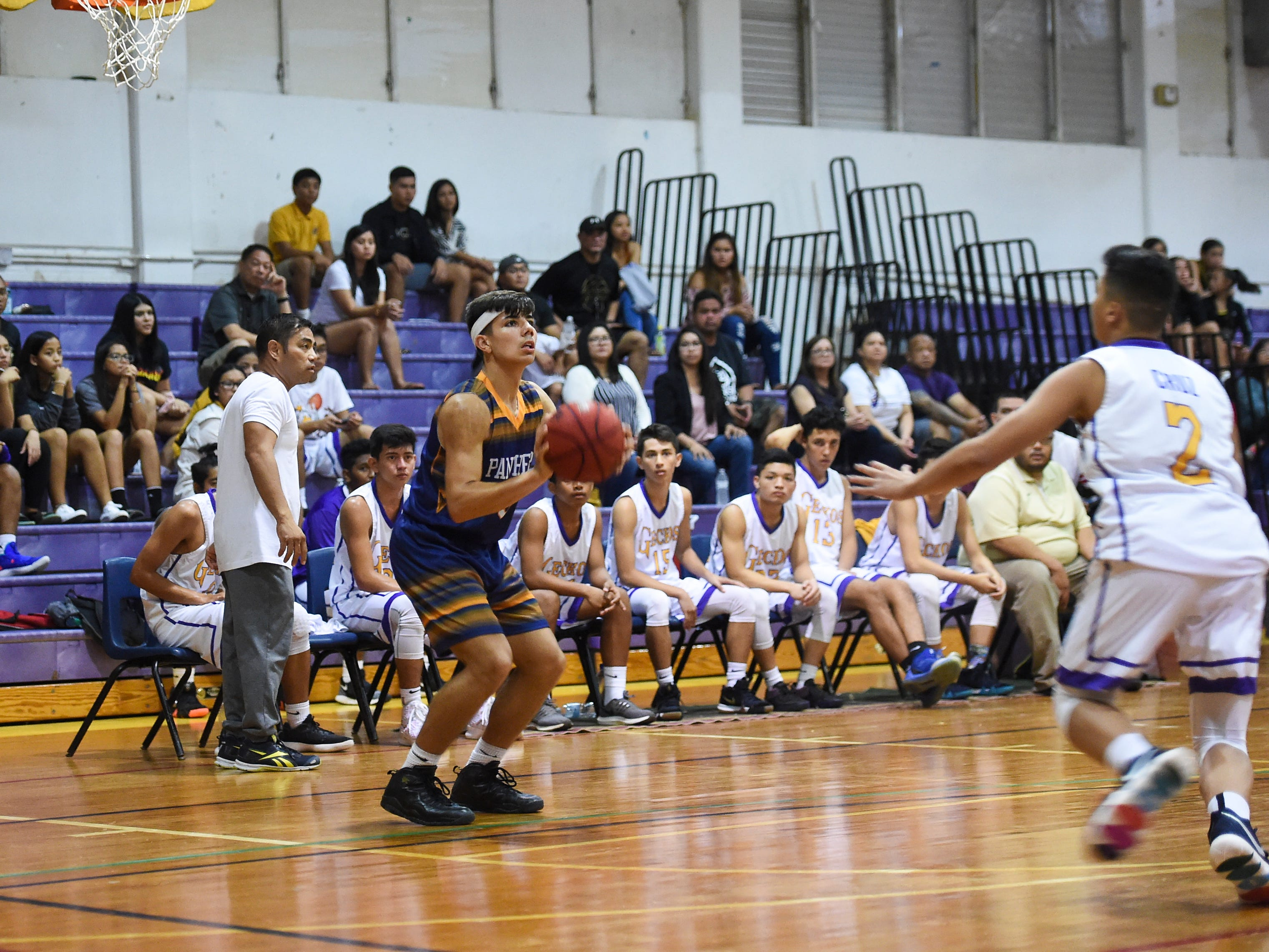 Guam High player Nick Keefe prepares to shoot a 3-pointer against the George Washington Geckos during an Independent Interscholastic Athletic Association of Guam Boys' Basketball game at the GW High School gym on Feb. 2, 2019.