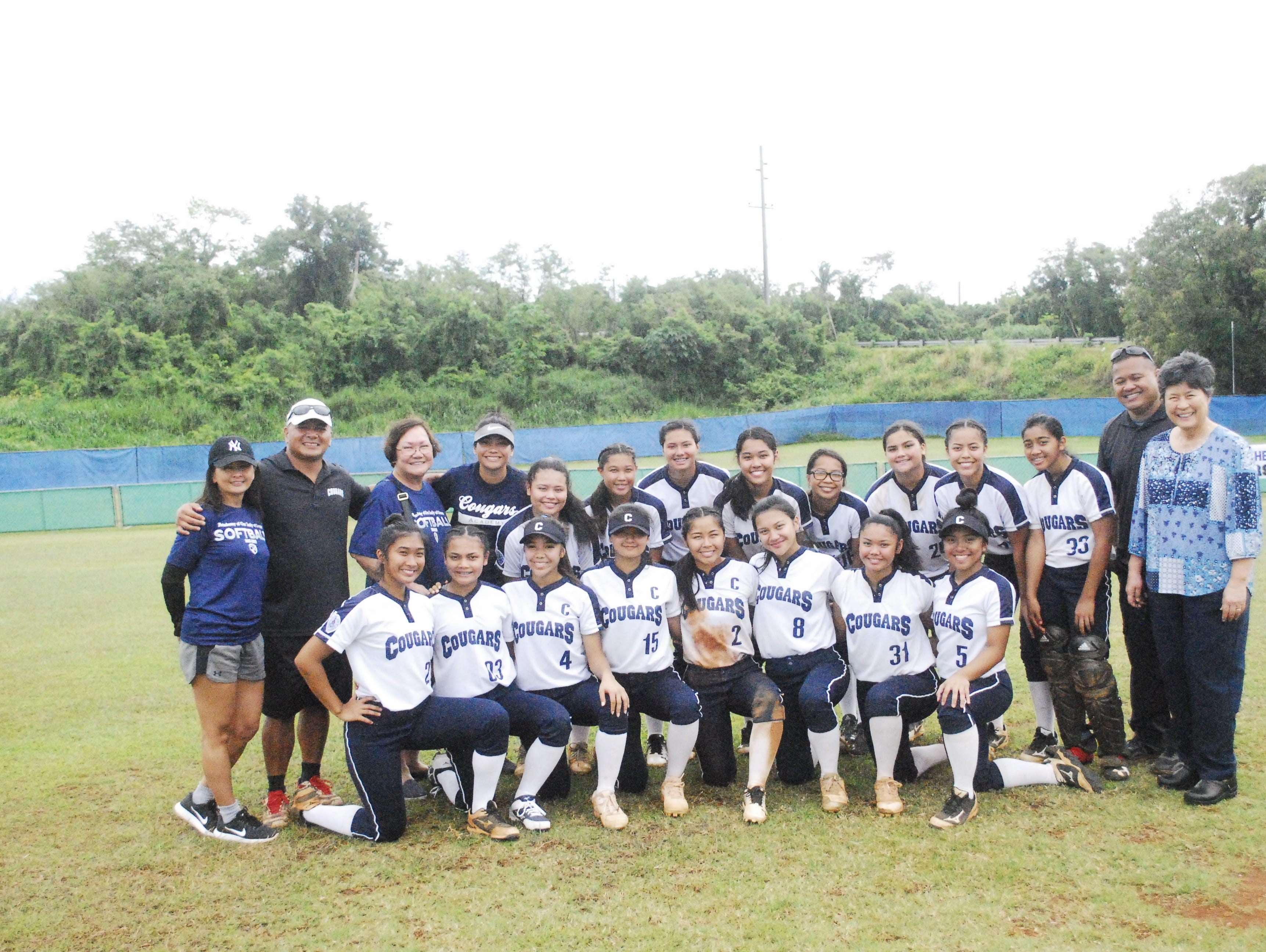 The 3-0 Academy of Our Lady of Guam Cougars softball team, following their  IIAAG High School Girls Softball game against the Simon Sanchez Sharks on Saturday, Feb. 2 at Tai Field in Mangilao.