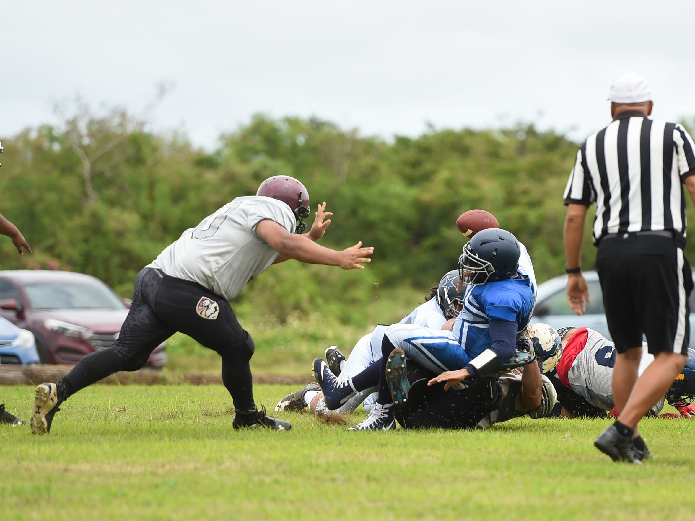 Southern Cowboys quarterback Smokee Hughes (9) is sacked by the Guam Raiders during their Budweiser Guahan Varsity Football League game at Eagles Field in Mangilao, Feb. 2, 2019.