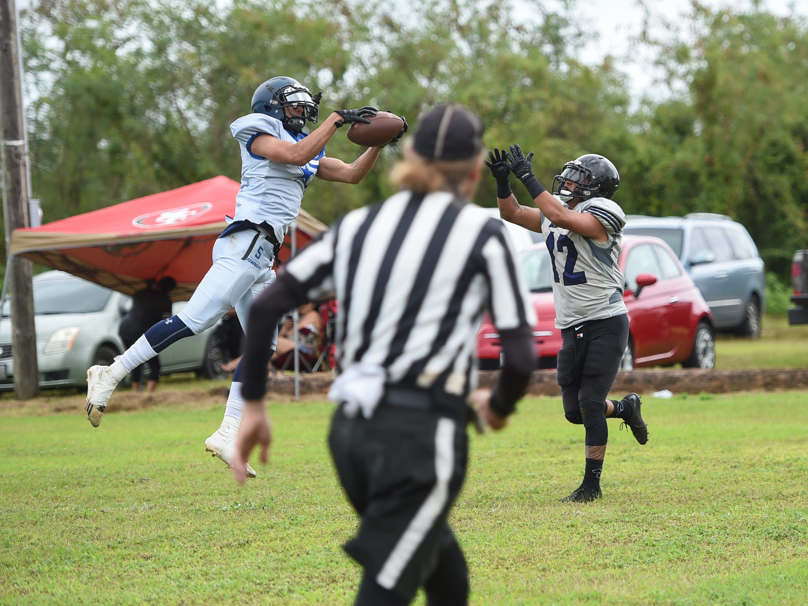 Southern Cowboys player Logan Hatcher (5) intercepts a pass intended for Guam Raiders' Storm Rosario (12) during their Budweiser Guahan Varsity Football League game at Eagles Field in Mangilao, Feb. 2, 2019.