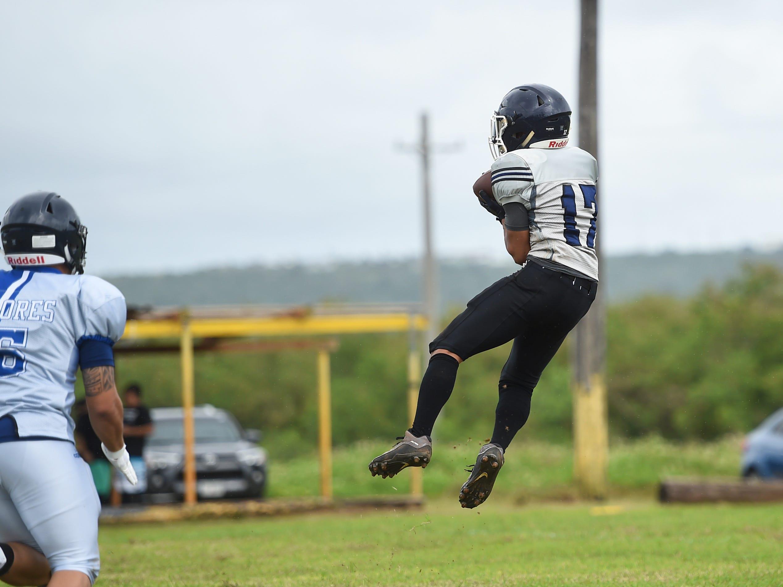 Guam Raiders player Spade Untalan (17) makes a catch against the Southern Cowboys during their Budweiser Guahan Varsity Football League game at Eagles Field in Mangilao, Feb. 2, 2019.
