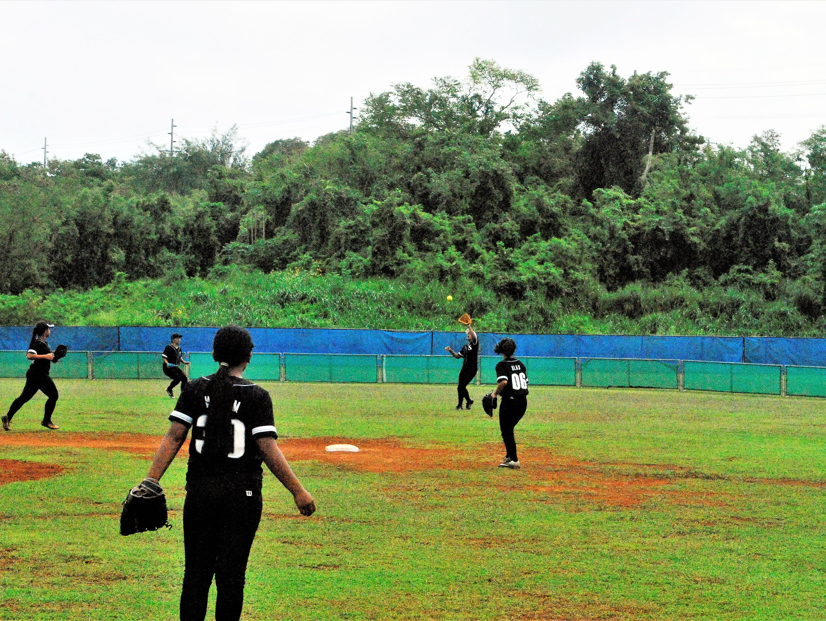Simon Sanchez Sharks' Carmen Gray secures an out against Academy during their IIAAG High School Girls Softball game on Saturday, Feb. 2 at Tai Field in Mangilao.