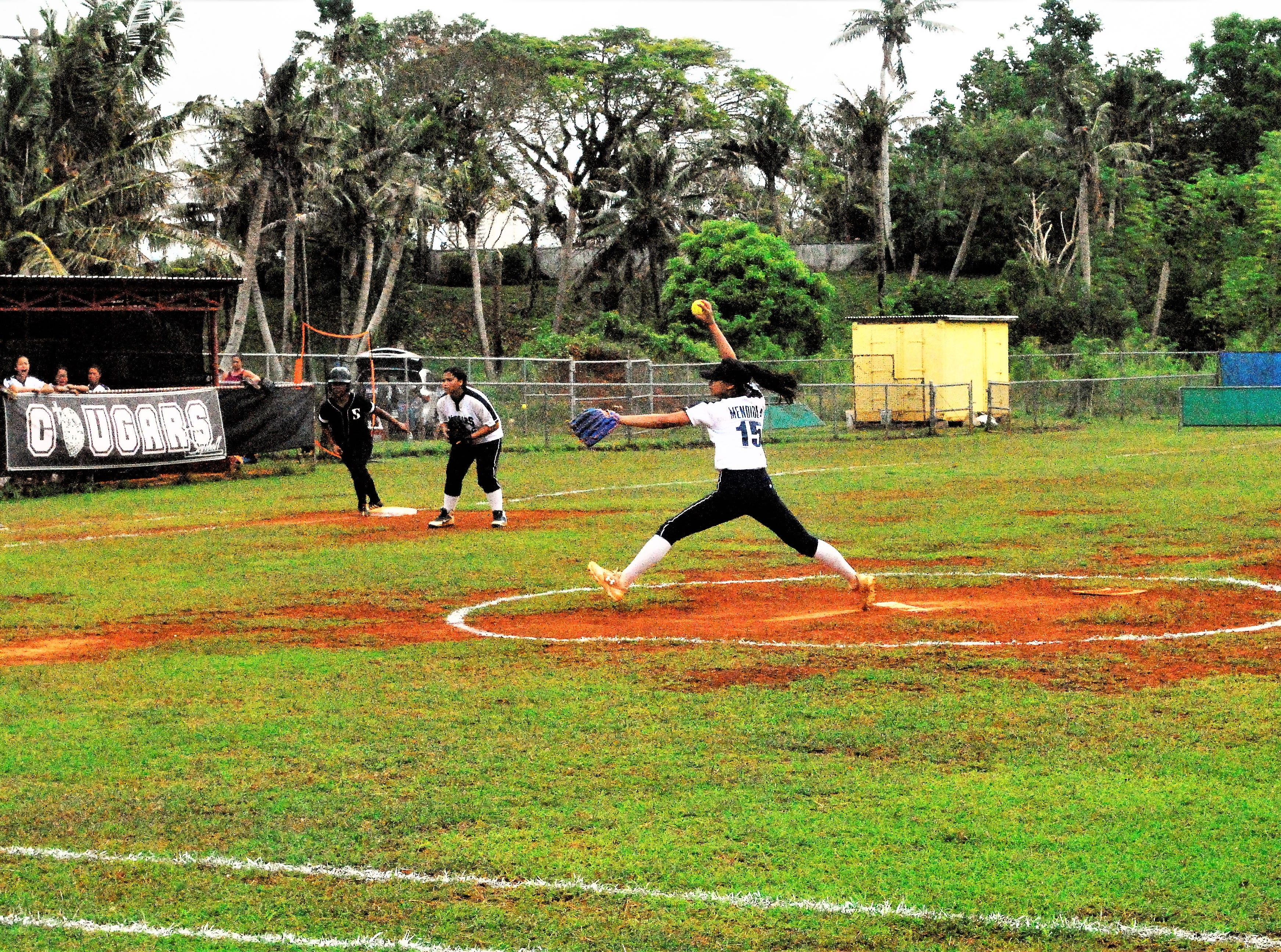 Academy pitcher Ashley Mendiola lets one loose against the Simon Sanchez Sharks during their IIAAG High School Girls Softball game on Saturday, Feb. 2 at Tai Field in Mangilao. Academy won 9-8.