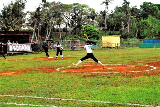Academy pitcher Ashley Mendiola lets one loose against the Simon Sanchez Sharks during an IIAAG Girls Softball game in this Feb. 2 file photo. Academy won 9-8.