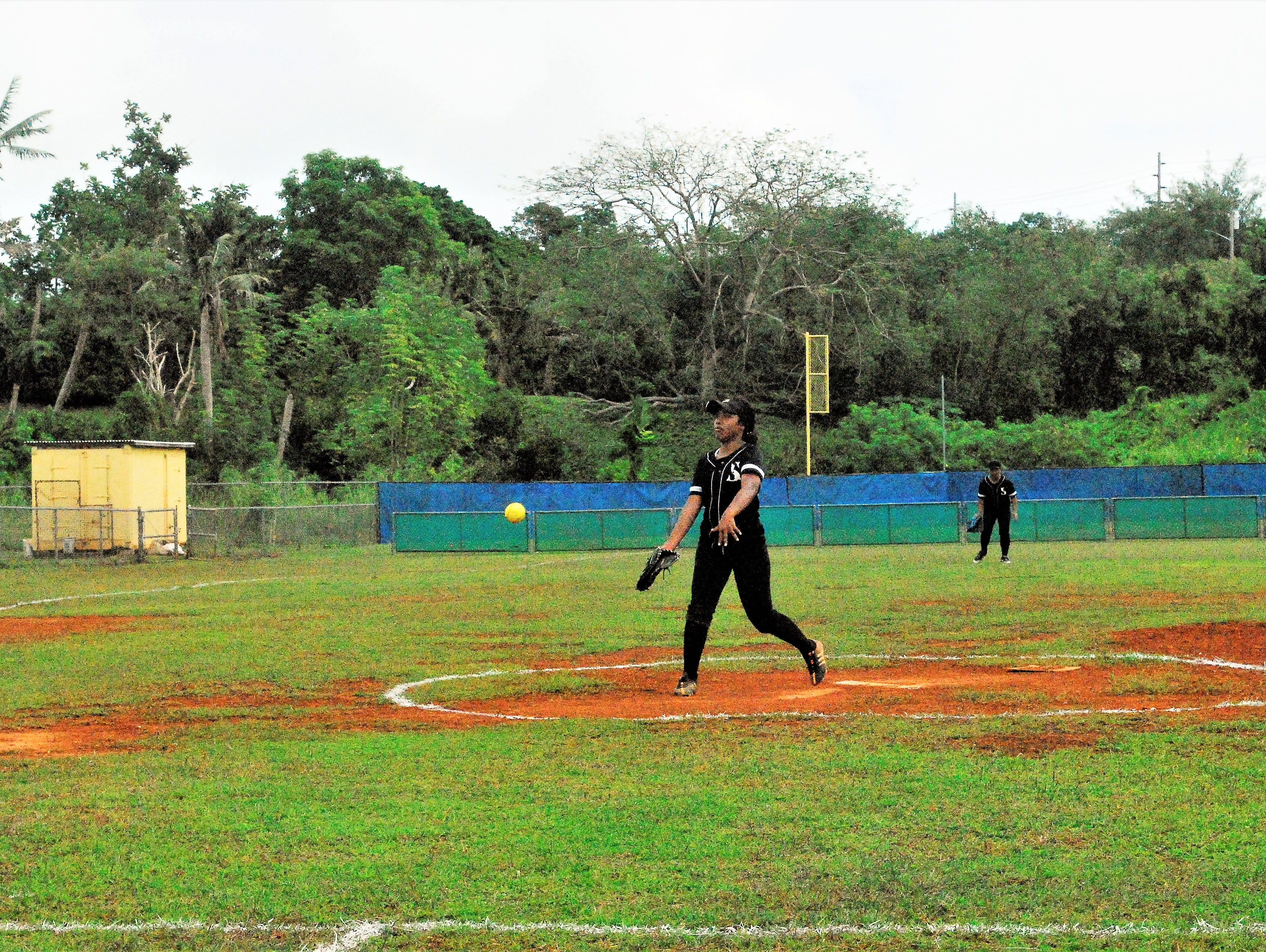 Simon Sanchez Sharks pitcher Ginae Joseph pitches against the Academy Cougars during their IIAAG High School Girls Softball game on Saturday, Feb. 2 at Tai Field in Mangilao.