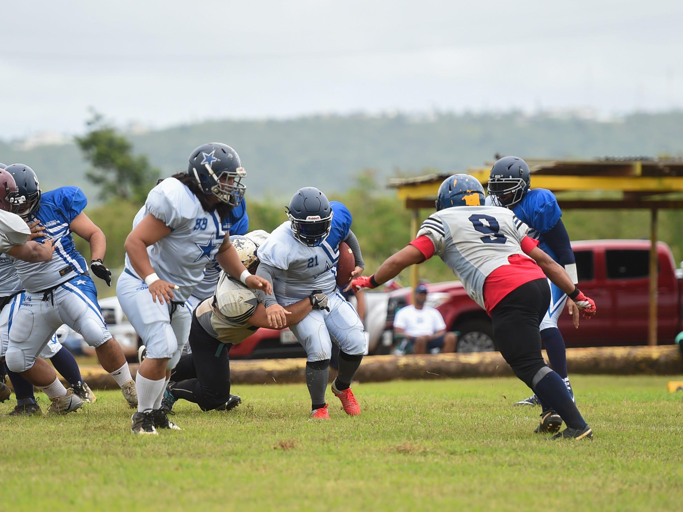 Southern Cowboys' Adam Lumba (21) runs the ball against the Guam Raiders during their Budweiser Guahan Varsity Football League game at Eagles Field in Mangilao, Feb. 2, 2019.
