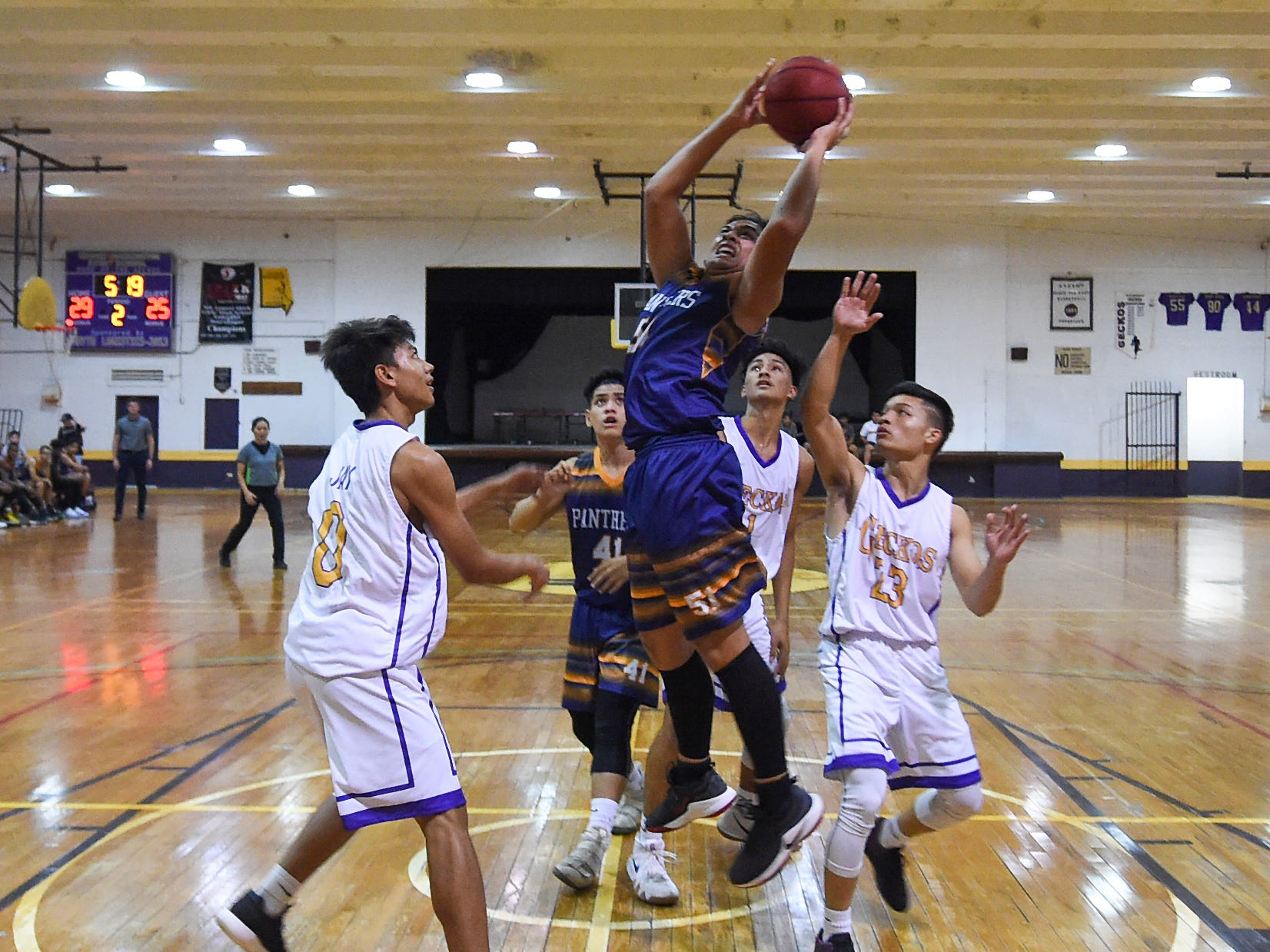 Guam High Panther Dillian Dela Cruz (51) takes it strong to the rim against the George Washington Geckos during their Independent Interscholastic Athletic Association of Guam Boys' Basketball game at the GW High School gym on Feb. 2, 2019.