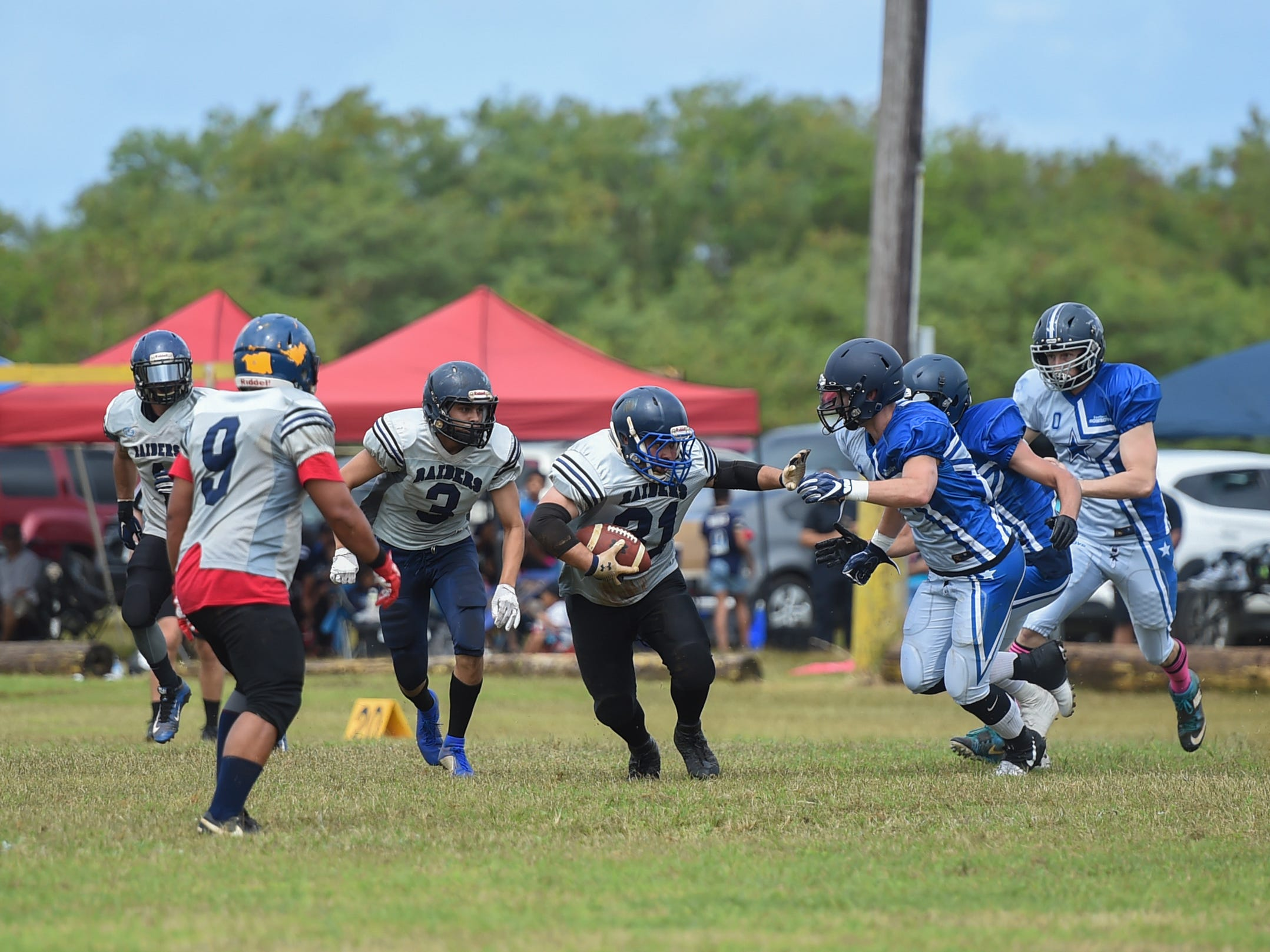 Guam Raiders player Andy Fernandez (31) rushes the ball against the Southern Cowboys during their Budweiser Guahan Varsity Football League game at Eagles Field in Mangilao, Feb. 2, 2019.