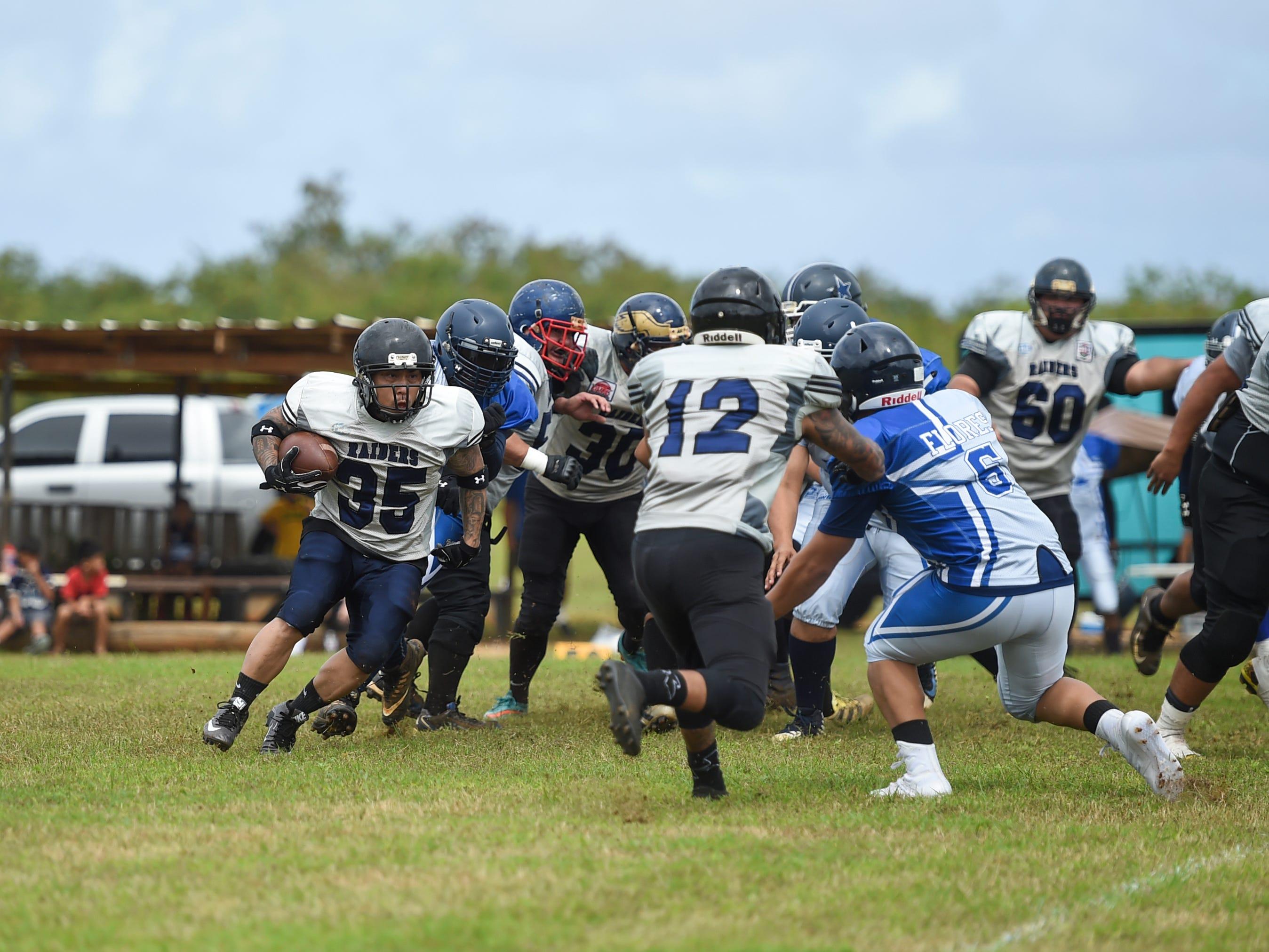 The Guam Raiders' Dave Delgado (35) rushes against the Southern Cowboys during their Budweiser Guahan Varsity Football League game at Eagles Field in Mangilao, Feb. 2, 2019.