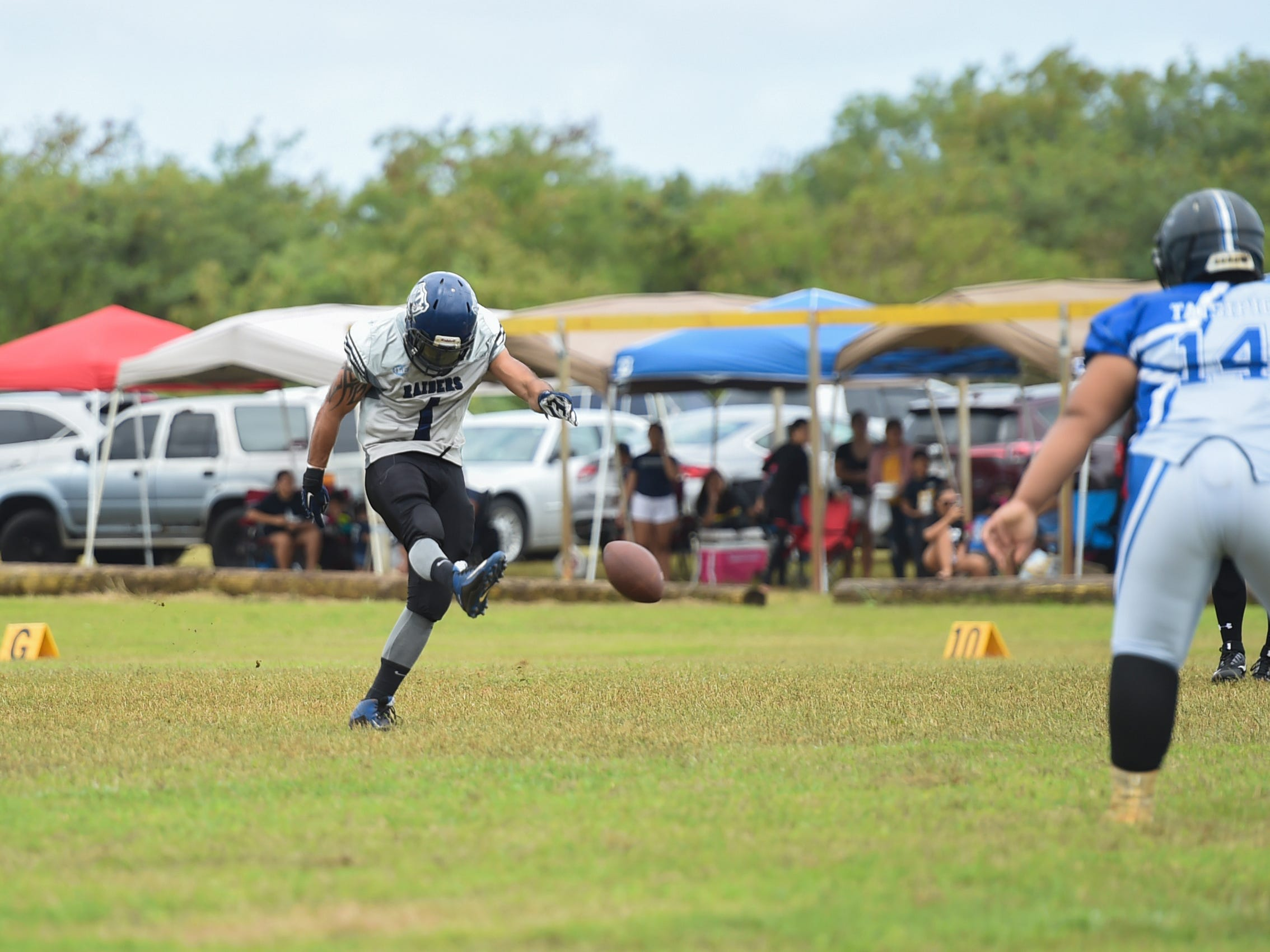 Guam Raiders player Casey Cruz (1) with the kickoff against the Southern Cowboys during their Budweiser Guahan Varsity Football League game at Eagles Field in Mangilao, Feb. 2, 2019.