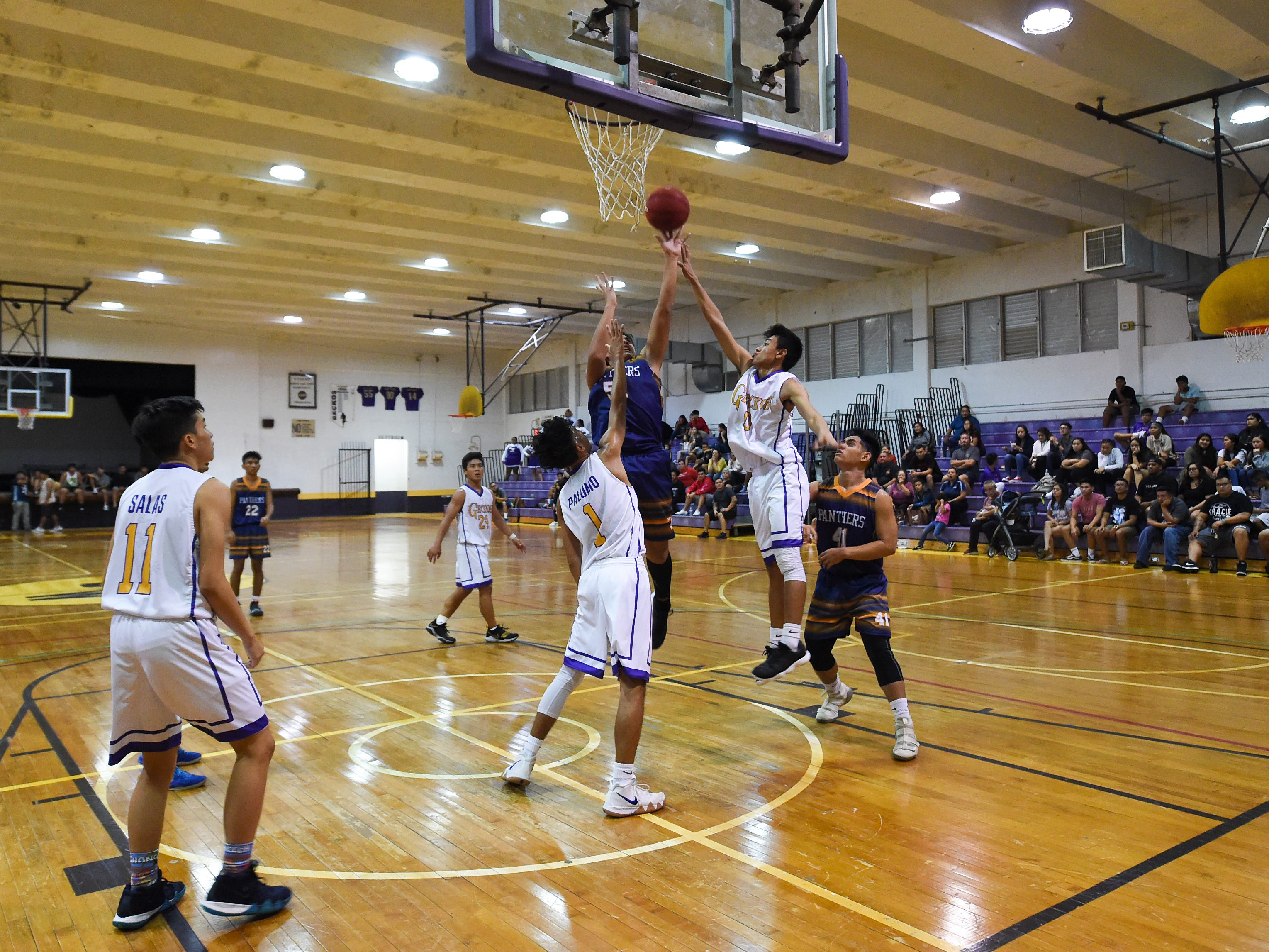 The George Washington Geckos and the Guam High Panthers hit the hardwood for an Independent Interscholastic Athletic Association of Guam Boys' Basketball game at the GW High School gym on Feb. 2, 2019.